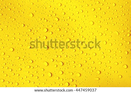 the water drop on fresh yellow background