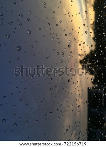 The water droplets on the car reflect sunlight in the morning. #722156719