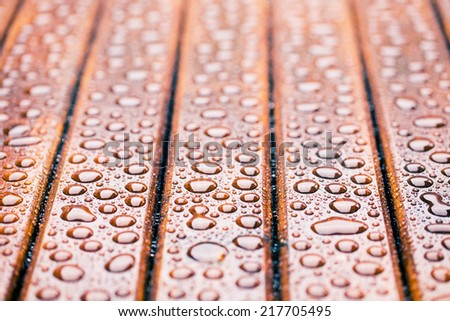 the water drops on wooden garden table