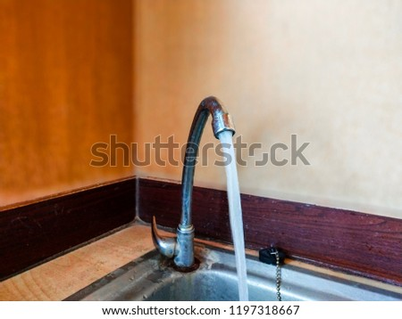 The water flow from the faucet in the bath. #1197318667