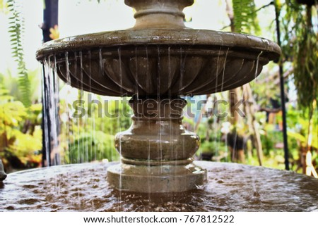 The water flowed down from the statue, molding marble all the time in the garden. ストックフォト ©