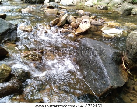 The water flowing in the stream #1418732150
