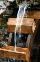 The water stream falls on a water-mill ladle