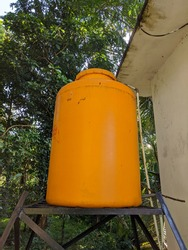 the water tank is supported by a steel structure and there is a water intake pipe