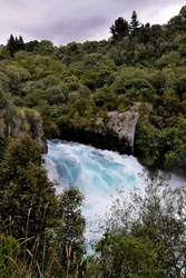 The waters of volcanic Lake Taupo emptying into the longest river in New Zealand, Waikato River via the spectacular Huka Falls.