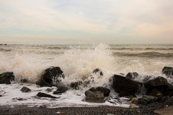 The waves of the sea hit the stones