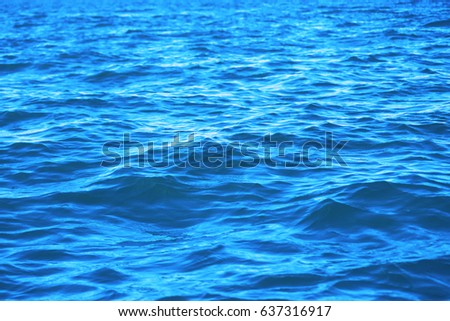 The waving blue water sea looking from a boat. #637316917