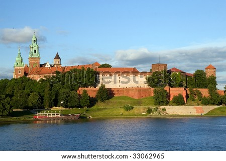 The Wawel Royal Castle in Cracow, Poland built in 14th at the behest of Casimir III the Great, rebuilt by Jogaila and Jadwiga of Poland. Vistula river on the first plan.