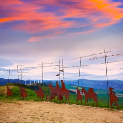 The way of Saint James Alto del Perdon top with steel sculpture of pilgrims at Navarra