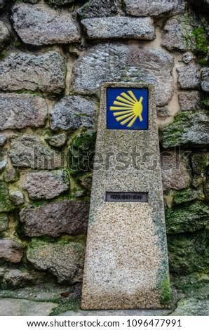 The Way of Saint James shell sign and arrow #1096477991