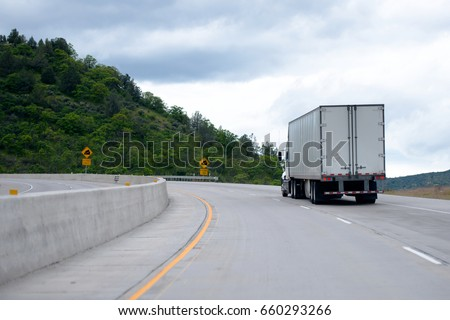 The way of transporting and delivering goods in America is reliable road transport with help of professional semi trucks with capacious and safe semi trailers on developed network of American roads #660293266