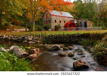 Photo of  The Wayside Inn Grist Mill with water wheel and cascade water fall in Autumn, Sudbury Massachusetts USA
