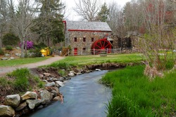 The Wayside Inn Grist Mill with water wheel in spring, Sudbury Massachusetts USA