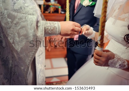 The wedding ceremony in the church priest wears wedding ring