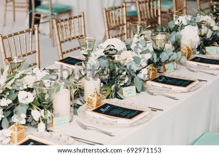 The wedding decor. The white flowers bouquet.