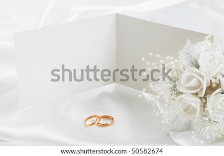 stock photo The wedding invitation with wedding rings and a bouquet of the
