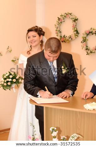 The wedding signature. Ceremony of wedding, a fastening the signature