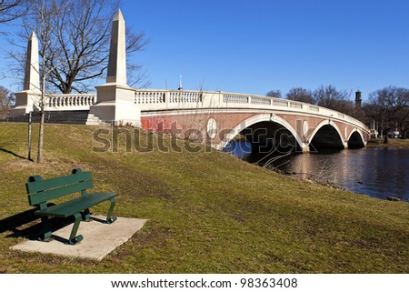 The Weeks Memorial Footbridge in Boston, Massachusetts overlooking Cambridge and the site of Harvard University on a sunny spring day.
