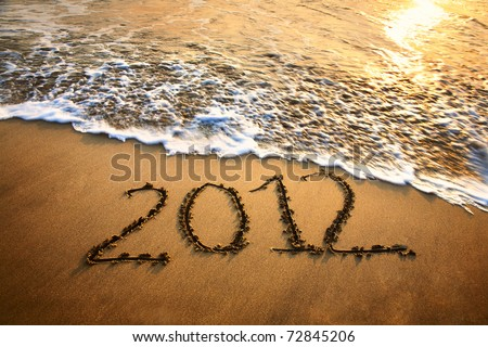 The welcome of the new year 2012 dramatic message in the sand at the beach near the ocean Сток-фото ©
