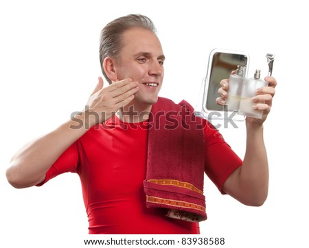 The well-groomed man uses balm after shaving
