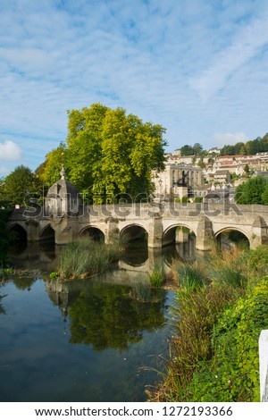 The well known ancient bridge over the River Avon with its one-time chapel and later lock-up in autumn sunshine, Bradford on Avon, Wiltshire, UK