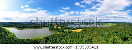 the westerwald forest with the dreifelder weiher lake in germany panorama