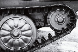 The wheels and caterpillars of a USSR military armored fighting vehicle. Black and white
