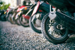 The wheels of the motorcycle are parked in line