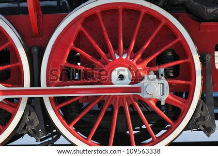 The wheels of the old steam locomotive, a fragment, close-up
