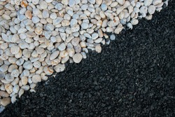 The white and black pebbles split each side in a yin and yang pattern.