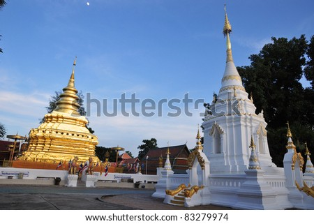 The White and Golden Pagoda in the evening. The Jomthong Pagoda in Wat (Temple) Phrathat Sri Jomthong, Chiang Mai Province, Thailand. This relic pagoda, kept the Buddhaâ??s right-side skull.