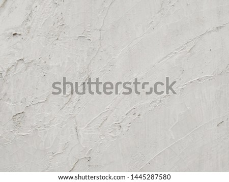 The white cement wall is a rough, neat and tidy look, intended to make a full surface area suitable for the background.