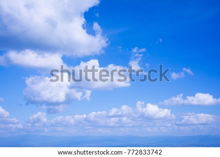 The white cloud on the blue sky in the bright day is suitable for being the nice background from the view of the highest point of Thailand. There are mountains being far at the below of the pic.