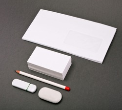 the white elements of corporate identity on a gray background, template for business cards template for placement of the logo