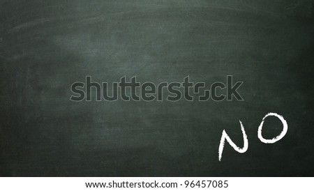 the white false symbol in the blackboard