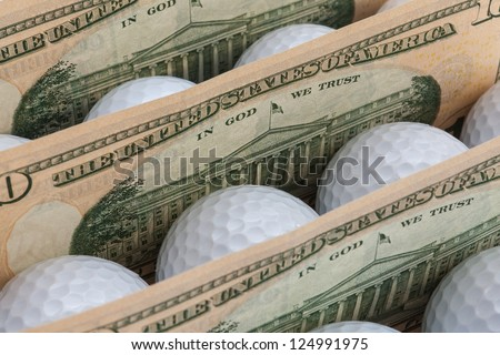 The white golf balls between American dollars banknotes