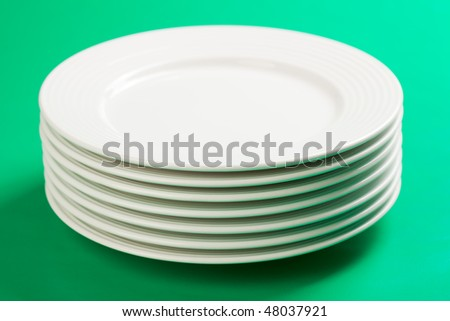 the white plate on green background