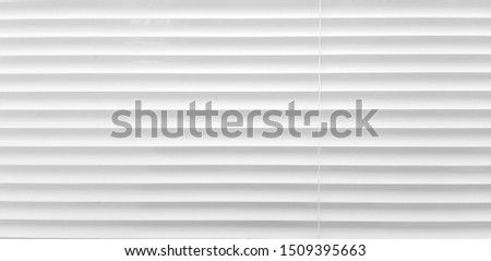 The white pleated blinds used to shade the sunlight coming into the window panes.  Use as a background image or background for building interior decoration. ストックフォト ©