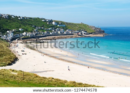 the white sandy beach and blue water at sennen cove near lands end in cornwall, england, britain, uk.