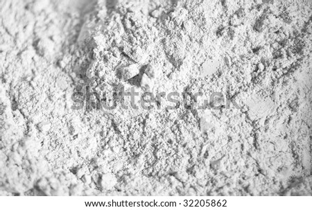 The white scattered powder similar to a flour. Abstract background. Shallow DOF