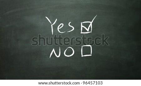 the white true symbol in the blackboard