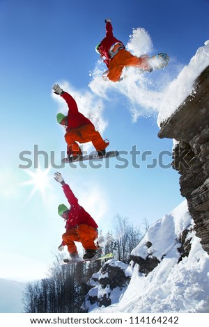 The whole jump of Snowboarder from high cliff in mountains