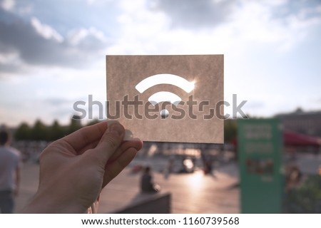 The Wi-Fi wireless network sign against the blue sky. The concept of