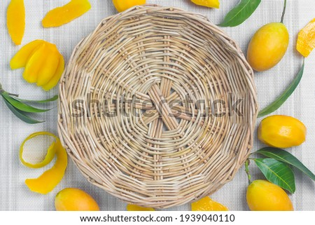 The wicker basket is placed in the middle. For text or logos and maprang around the fabric background. Stok fotoğraf ©
