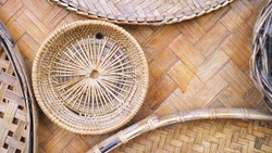The wickerwork decorating on bamboo wicker wall. The old charming traditional handcraft in Thailand. The concept of cultural and traditional conservation, Thai classic wisdom.