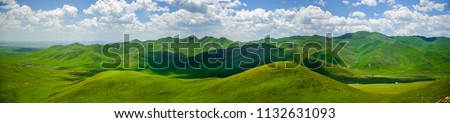 The wide and wide picture, the blue sky and white clouds, the beautiful boundless green mountain grassland. #1132631093