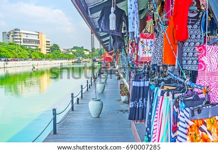 The wide range of stalls, offering clothes, shoes, souvenirs and other goods in Pettah Floating Market, Colombo, Sri Lanka. #690007285