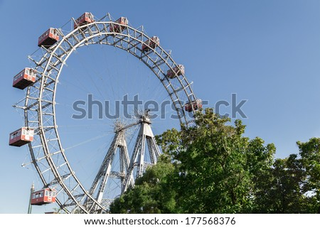 The Wiener Riesenrad is a Ferris wheel at the entrance of the Prater amusement park in Vienna, It is one of most popular tourist attractions in Vienna. Austria Stock photo ©