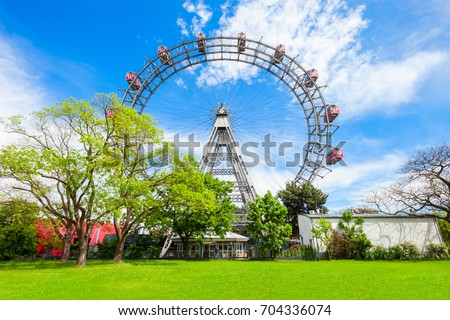The Wiener Riesenrad or Vienna Giant Wheel 65m tall Ferris wheel in Prater park in Austria, Vienna. Wiener Riesenrad Prater is Vienna's most popular attractions. Stock photo ©
