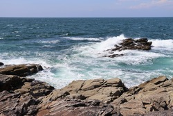 The wild coast of Quiberon in Brittany , France is a beautiful seascape with rocks and waves